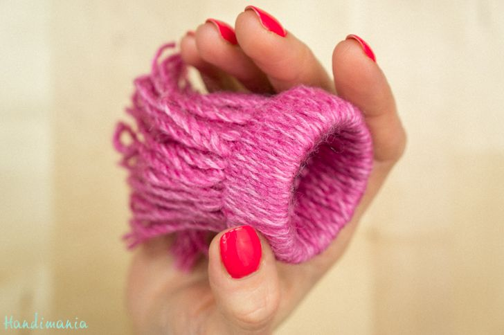Wind yarn onto strips of toilet paper rolls to make these cute tiny hats