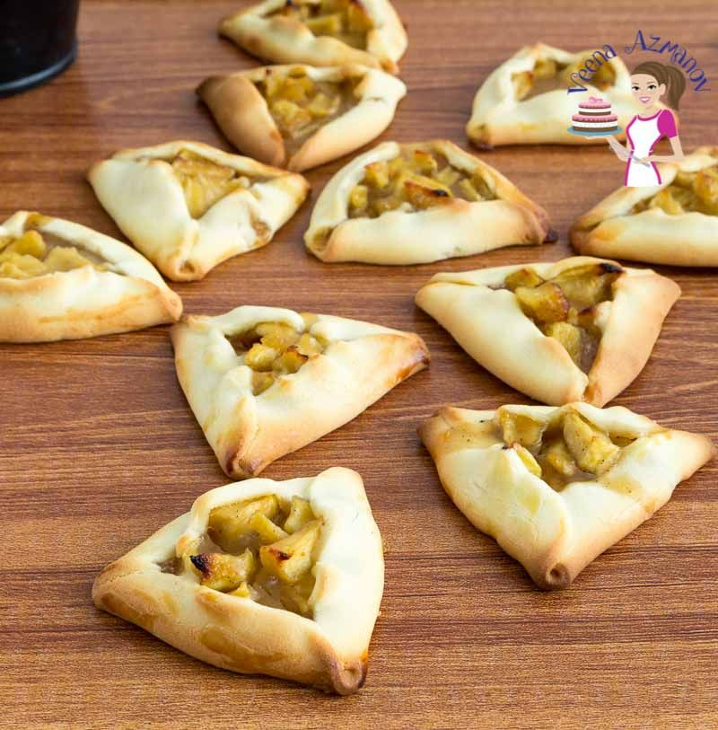 These Apple Pie Hamantaschen are a beautiful twist to the traditional Purim Cookies. Crisp shortbread wrapped around sweet moist apple pie filling