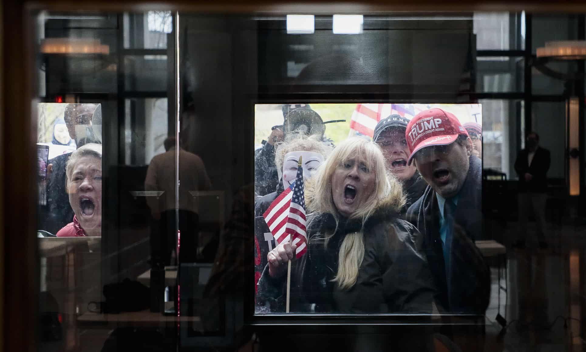 Fury and despair behind the viral image of Americans