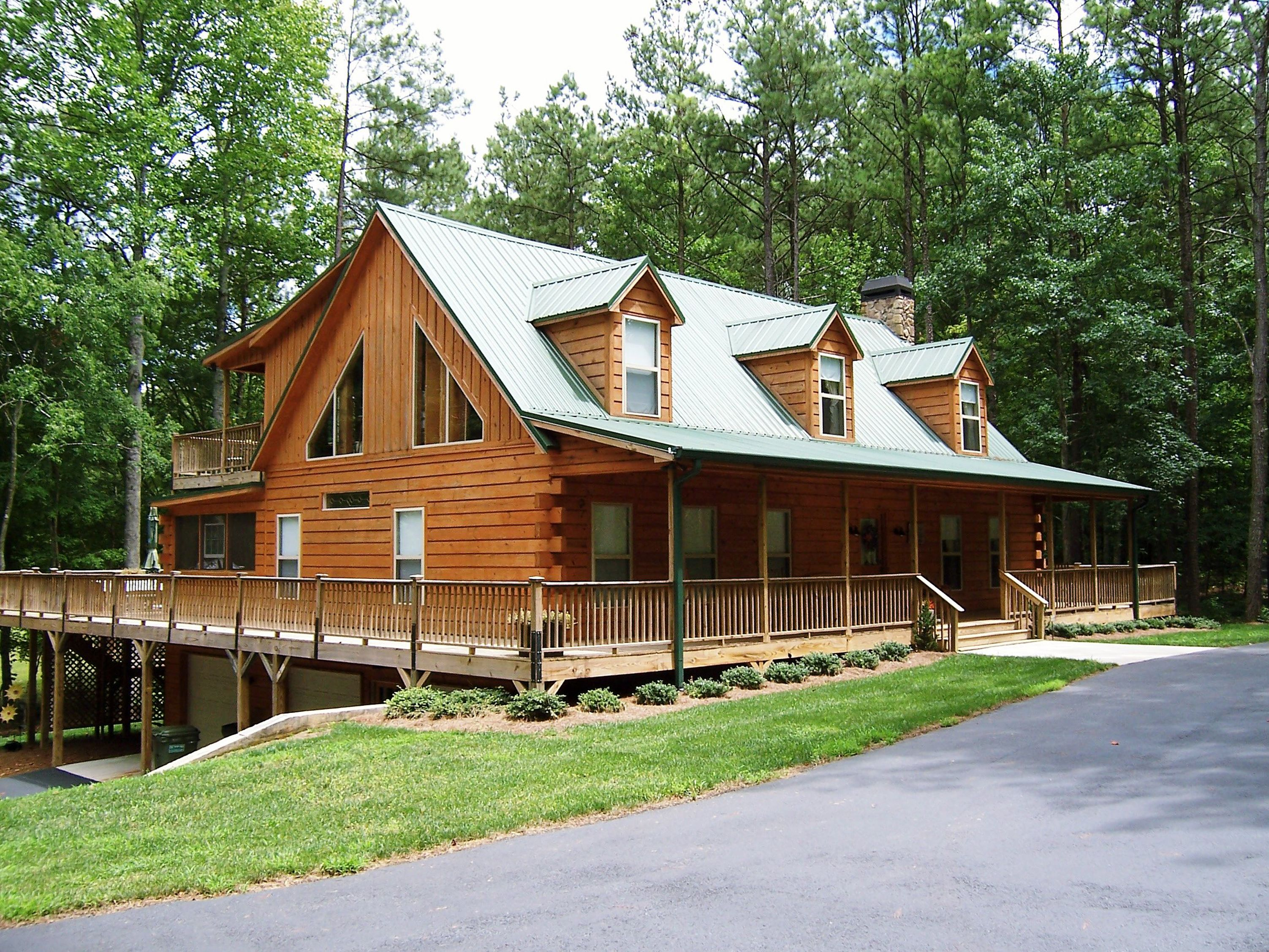 Modular cabin with split log siding by nationwide homes for Rustic log homes