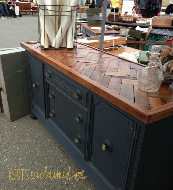 A gorgeous Herringbone Buffet by Nicole of Roots Reclaimed created with Madrone wood and Graphite Chalk Paint® decorative paint by Annie Sloan!