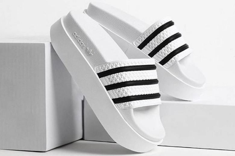on sale a7dea ee90a Todays Crush adidas Originals Adds Height To Its Adilette Slides -  MISSBISH  Womens Fashion, Fitness  Lifestyle Magazine