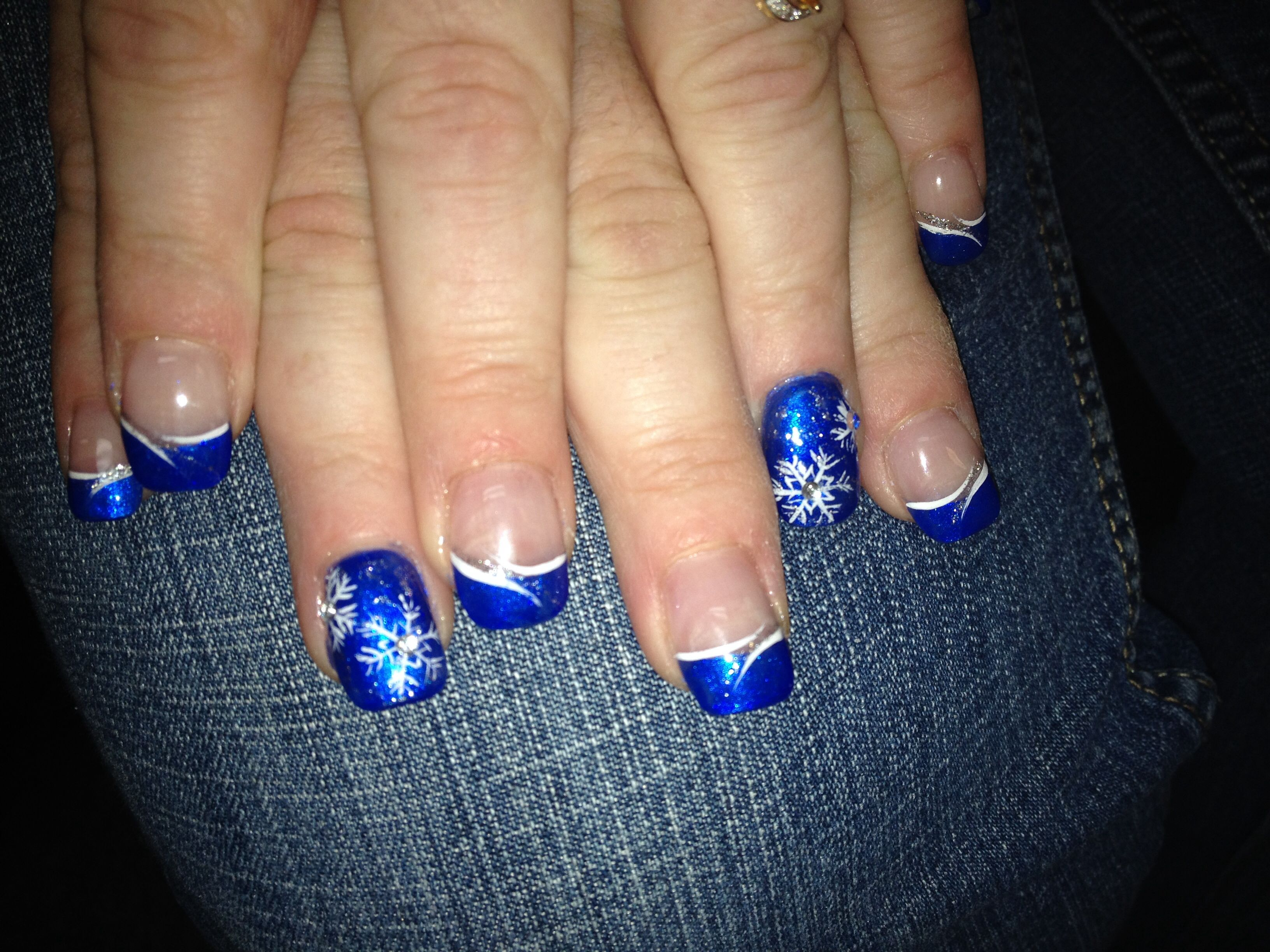 Blue Nails With Snowflakes Design On The Ring Fingers Winter