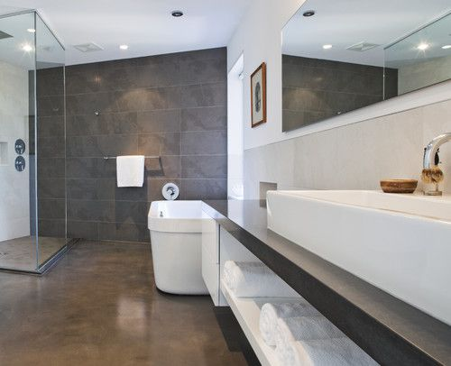 Modern Bath With Concrete Floors And Custom Vanity Storage By Kbcdevelopments