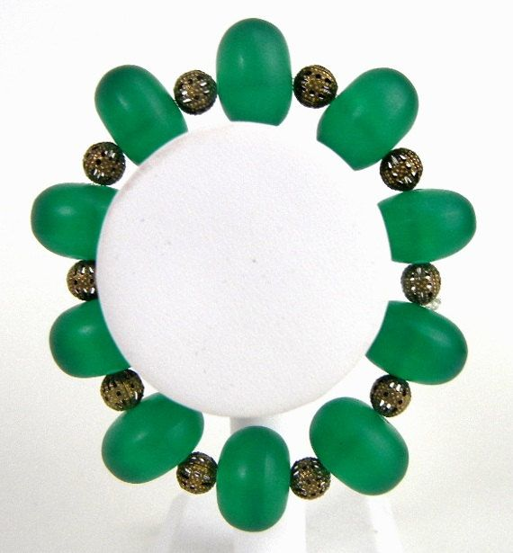 Bold bracelet of emerald green vintage glass by MadMamaMiller
