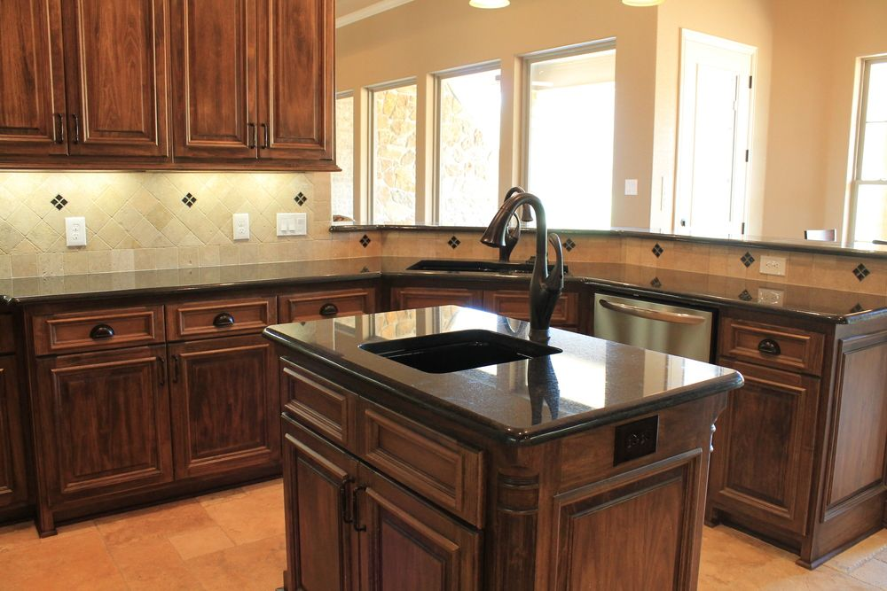 Kitchen with wood stain cabinets and black granite. | Home ... on Black Granite Stain  id=63962