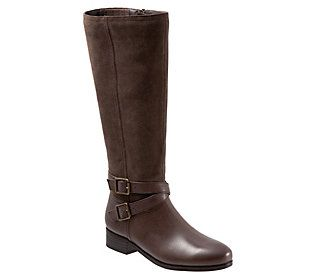 Fabulous and fun, this tall boot features an inside zipper and covered goring, providing a perfect fit every time. The soft tumbled leather combines with casual suede for a weathered look, finished with two decorative buckles. From Trotters.
