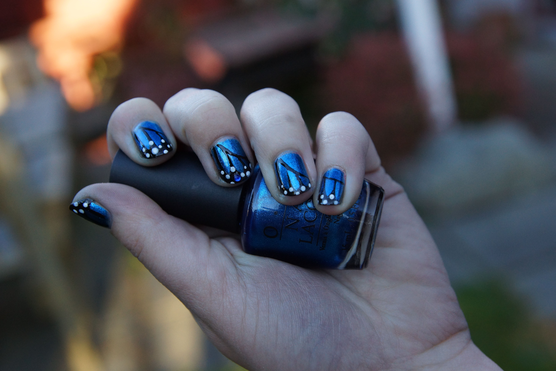 Blue monarch nails by Cassandra Jane.