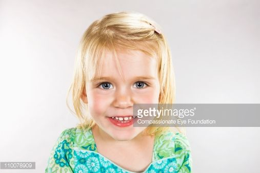 Stock Photo : Close up portrait of smiling young girl