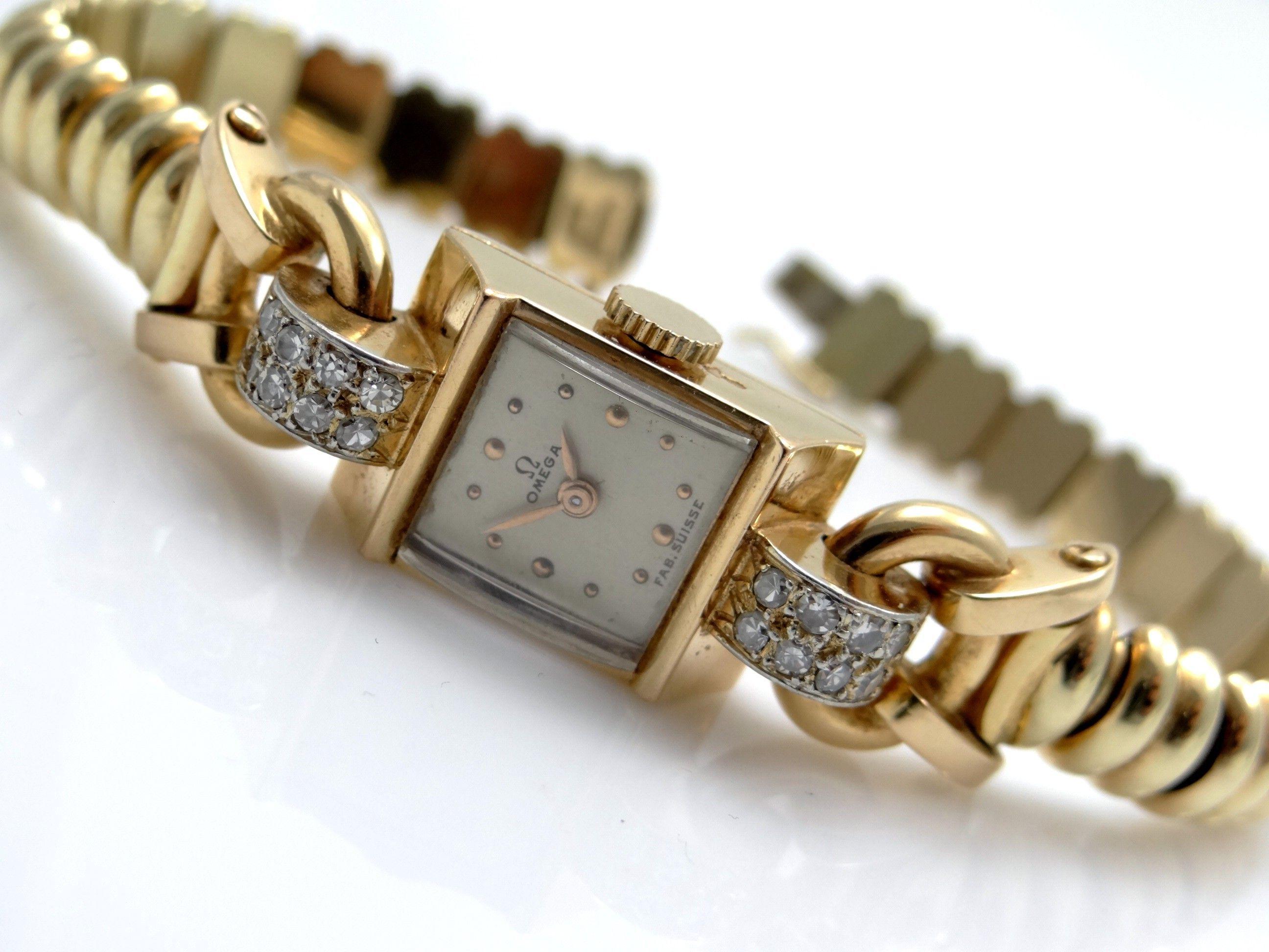 Omega damenuhr gold 585  Modeschmuck