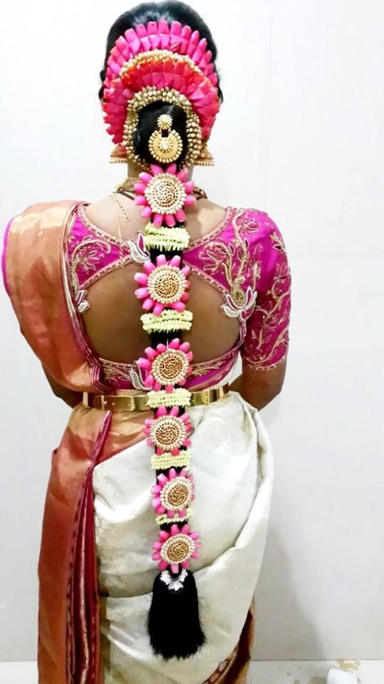 Traditional Southern Indian bride's bridal braid hair. Hairstyle by