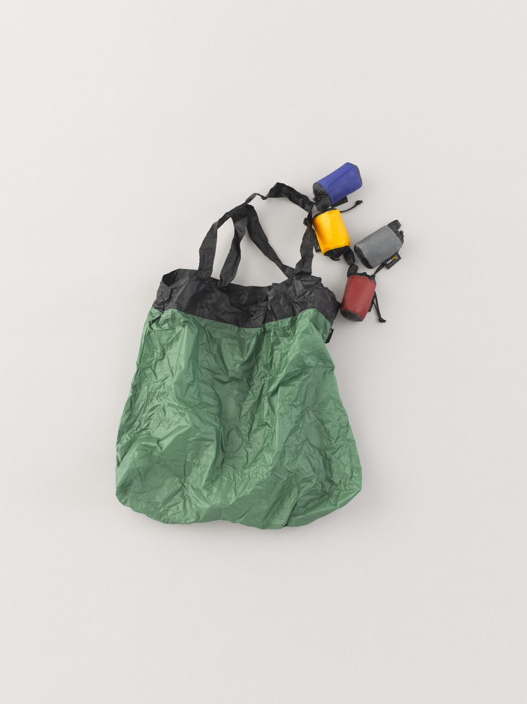 71f135508229 Yves Behar recycles boat sails and wetsuits to produce Deep Blue Bag ...