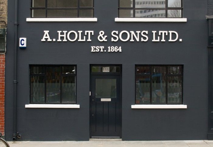 A. Holt & Sons Ltd. Storefront | Light typography on dark contrast facade