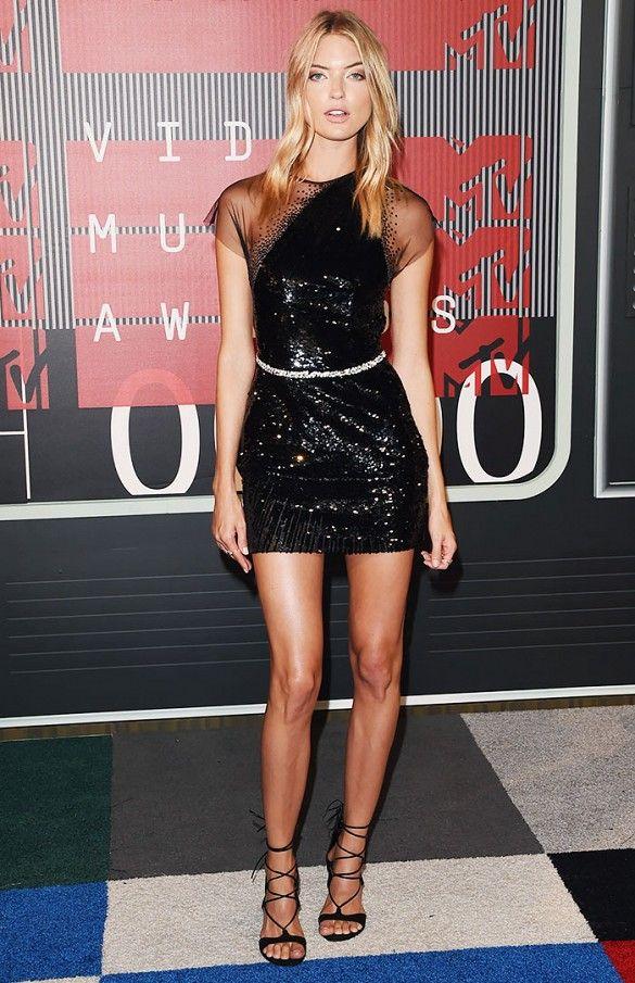 0e3c6de734bd Martha Hunt wears a black sequin mini dress with lace-up sandals