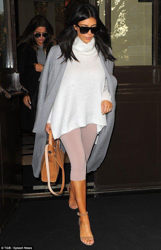 Kim and Khloe Kardashian leave London wearing sung