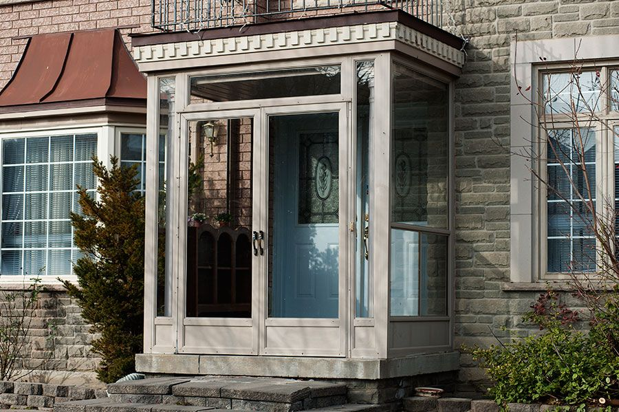 Enclosed front porch with storm door porch enclosure in for Front entry doors with storm door