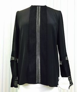 Size: FR 36/ US 6, color: black, fabric 100% silk. Made in France. This gorgeous blouse will stand out on any occasion.