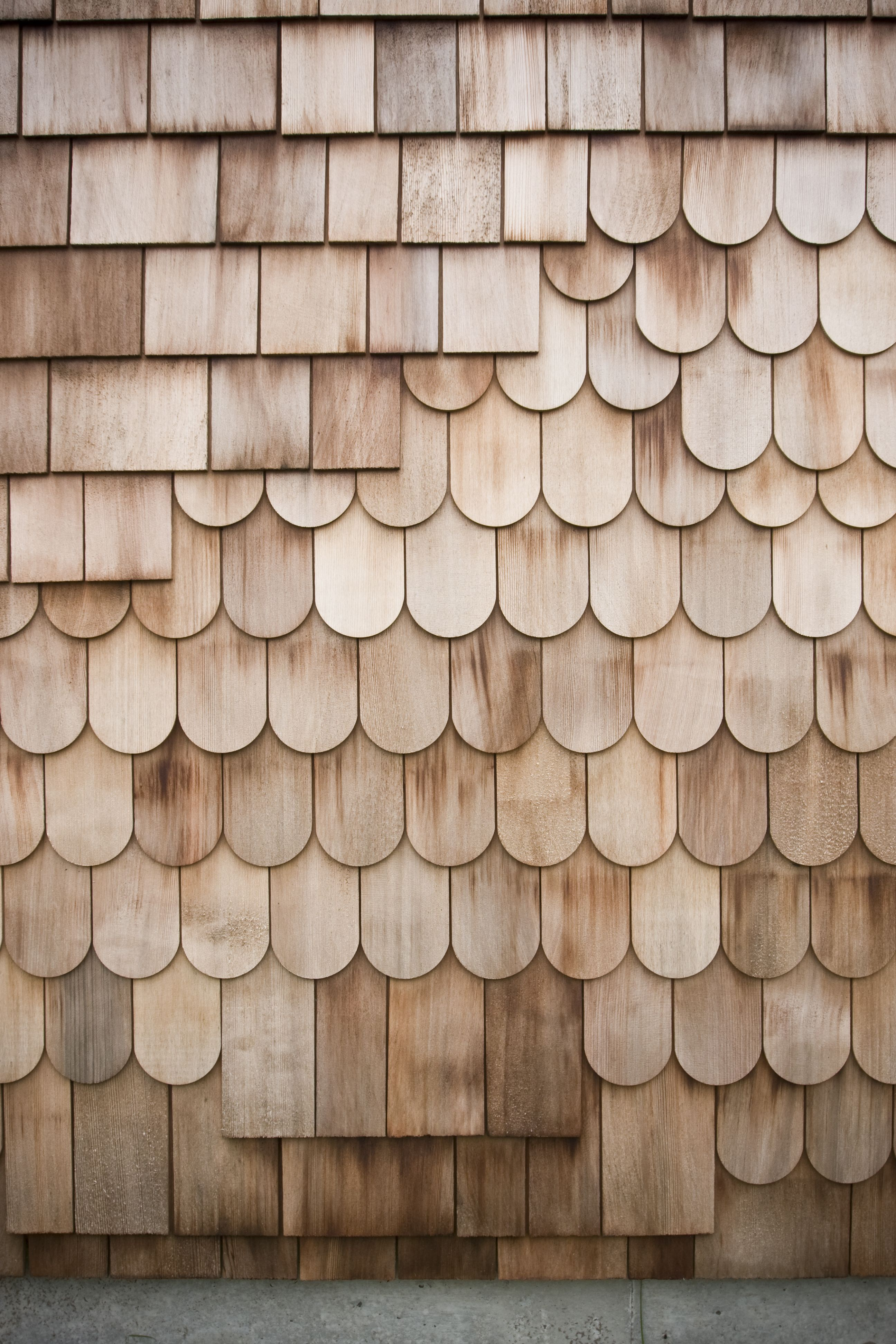 A Mix Of Red Cedar Shingles And Scales Make Of The Exterior The Design Is Intended To Be A Wood Cladding Interior Cedar Shingles Wood