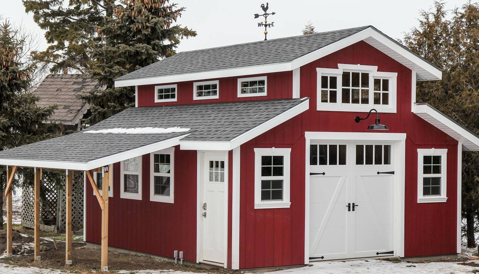 Charming red barn garage featuring clopay coachman for Pole barn style garage