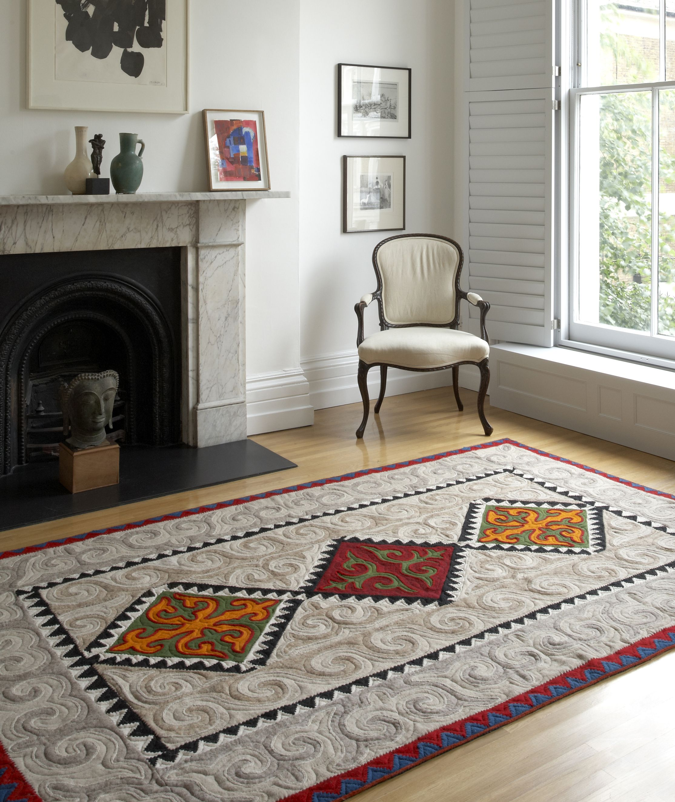Large Shyrdak Felt Rug With A Bright Diamond Pattern Set Against A Neutral Background Feltrugs