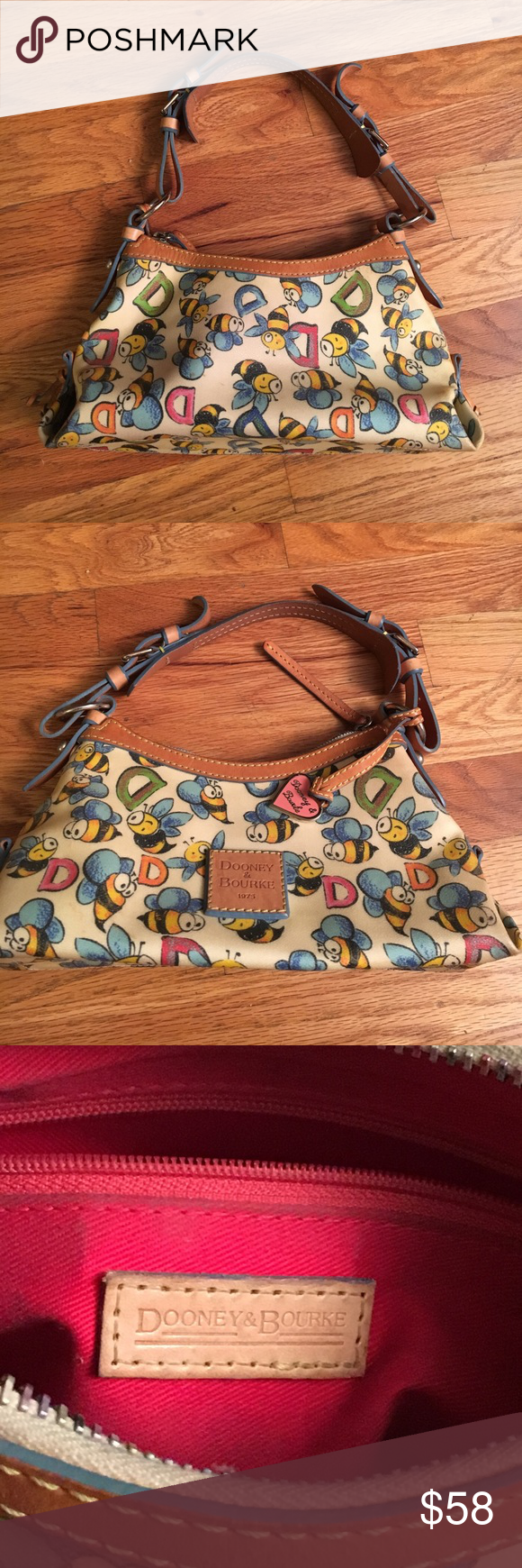 Sale today-Dooney and Bourke small purse Preowned, original. Bumble bee 🐝 pattern with rainbow zipper. See photos for signs of wear inside Dooney & Bourke Bags