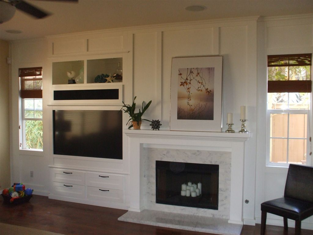 Built in white entertainment center next to fireplace How to build an entertainment wall unit