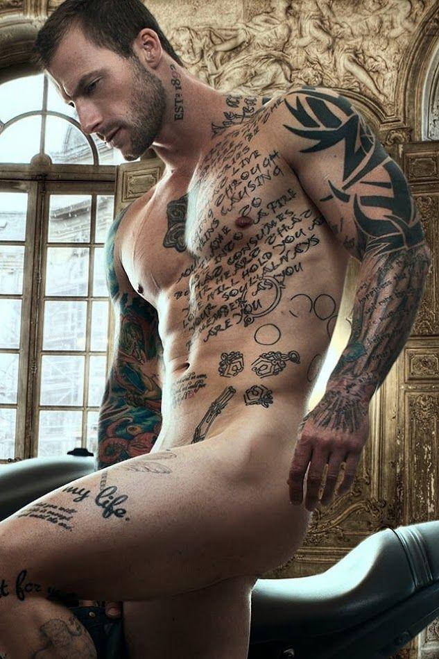 Tattooed nude boy with semi hardon