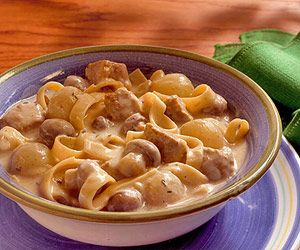 Veal and mushrooms are served in a flavorful sauce of beef broth, wine, and evaporated milk. Ladle this low-fat veal stew over noodles.