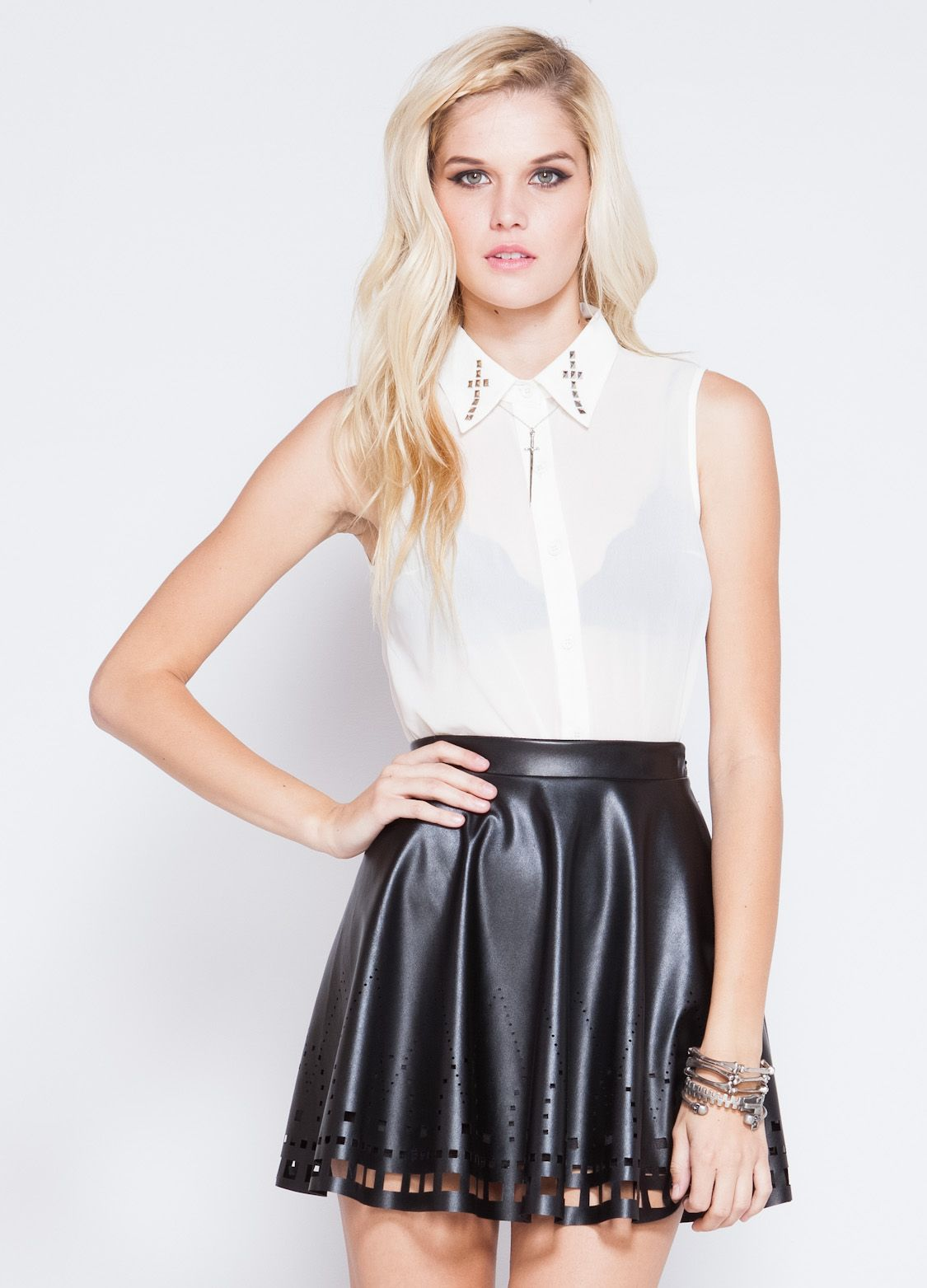 32ce07e4c2 Faux leather skater skirt with cut-out detail at bottom. Zipper back  closure. 100% polyester 18 length Model is wearing size S