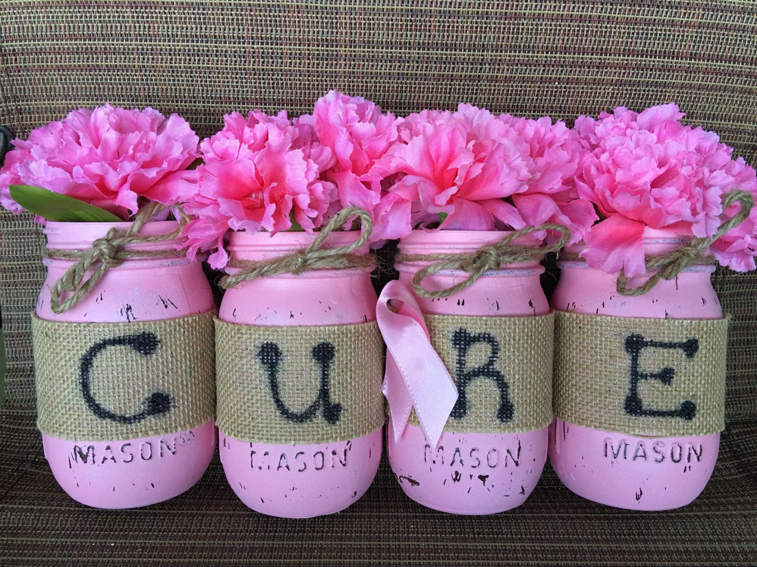 A personal favorite from my Etsy shop https://www.etsy.com/listing/400000269/breast-cancer-awareness-mason-cups-cure