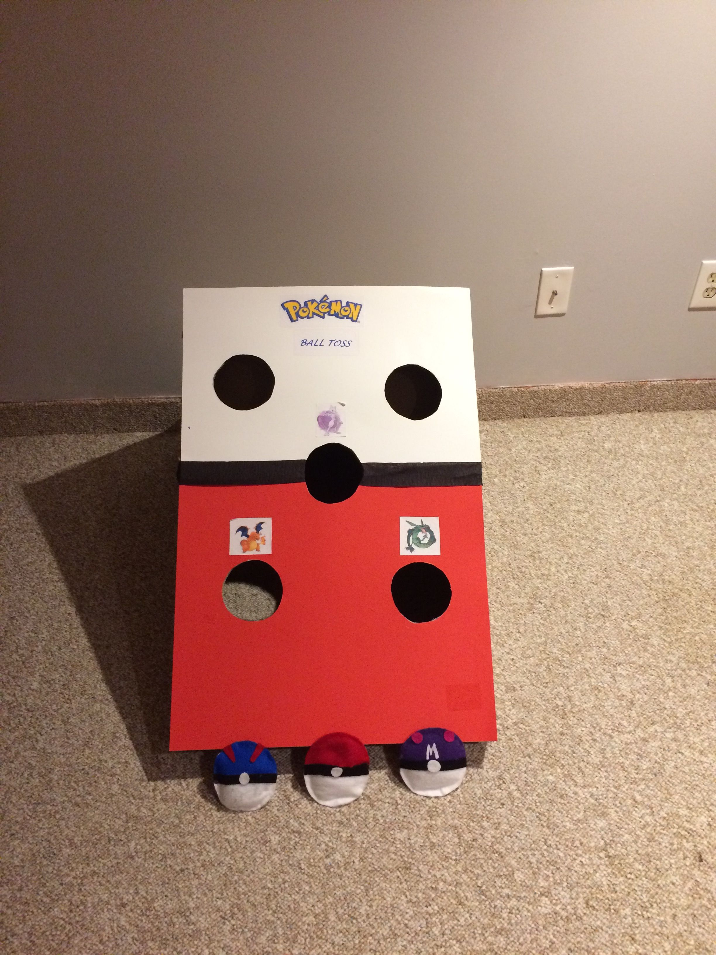 Diy Pokeball Bean Bag Toss Cut A Box Diagonally And Holes With Cutter Placed