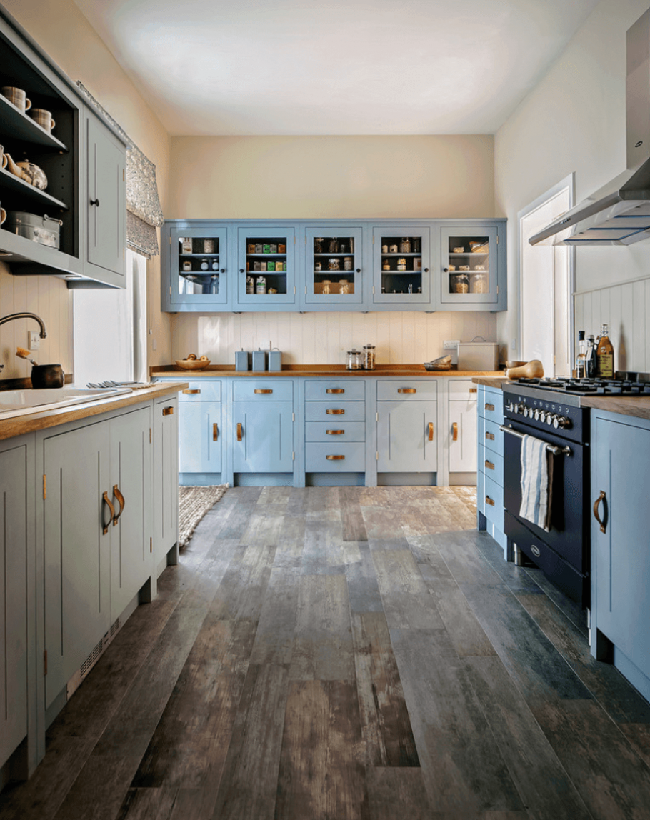 Light Blue Polished Wooden Kitchen With Stove And