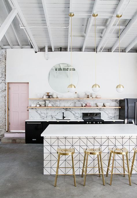 gorgeous kitchen, counter, and gold bar stools