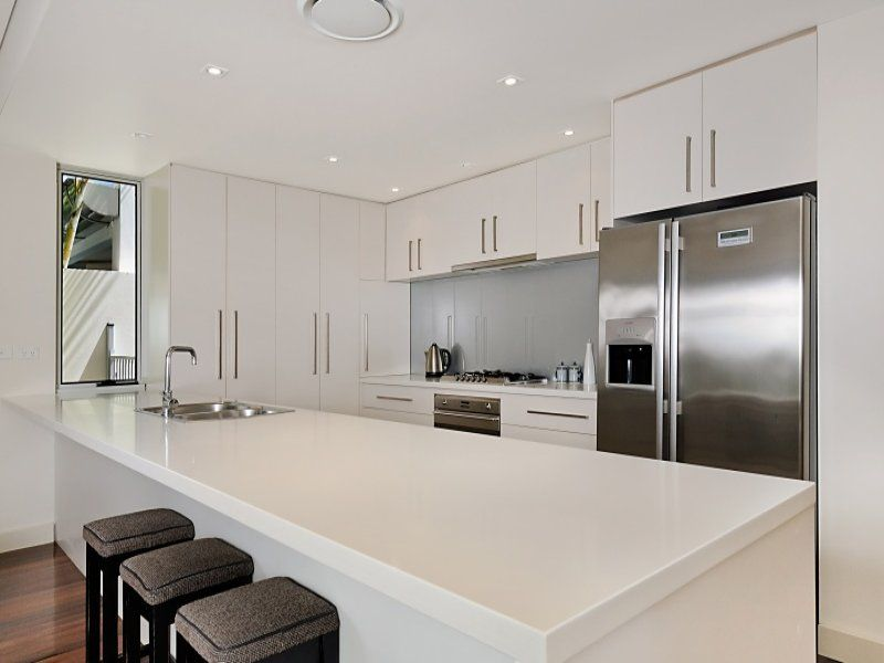 Contemporary galley kitchen efficiency with galley for Modern kitchen designs gallery
