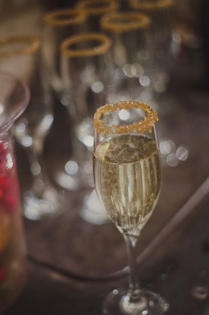 Gold sugar crystals on champagne glasses Katie Purnell photo AislinnEvents.com destination wedding planning