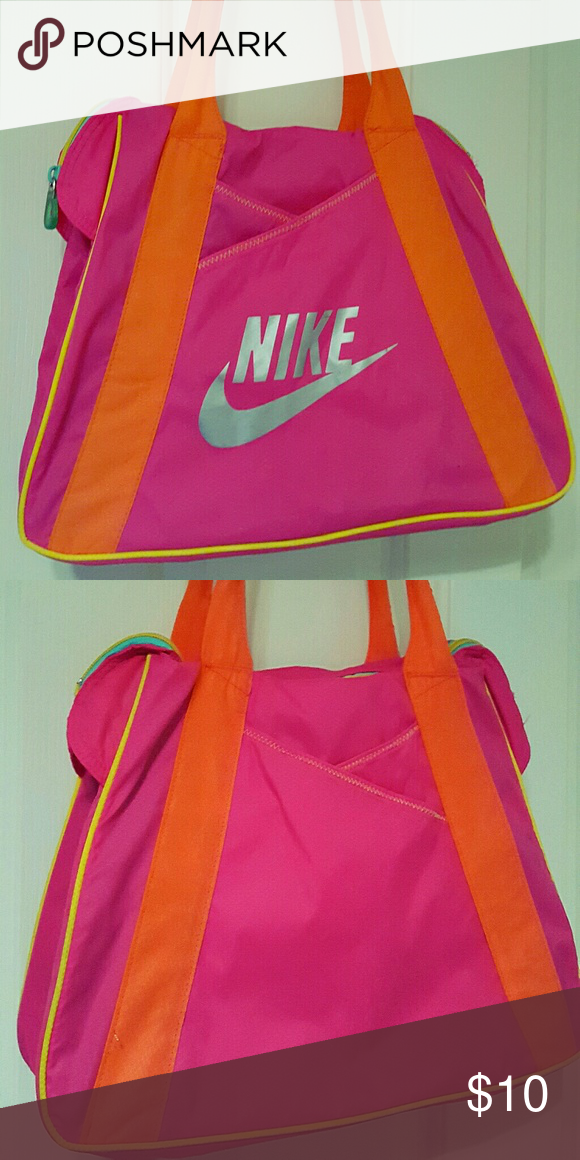 021fe02301d Vintage Nike Bag Pink, old school Nike over-the-shoulder bag with yellow,  teal, and orange accents and a silver swoosh on the front.