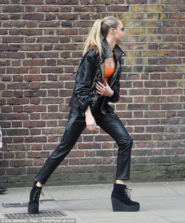 Cara Delevingne rocks an orange latex bra for first face of Rimmel ad
