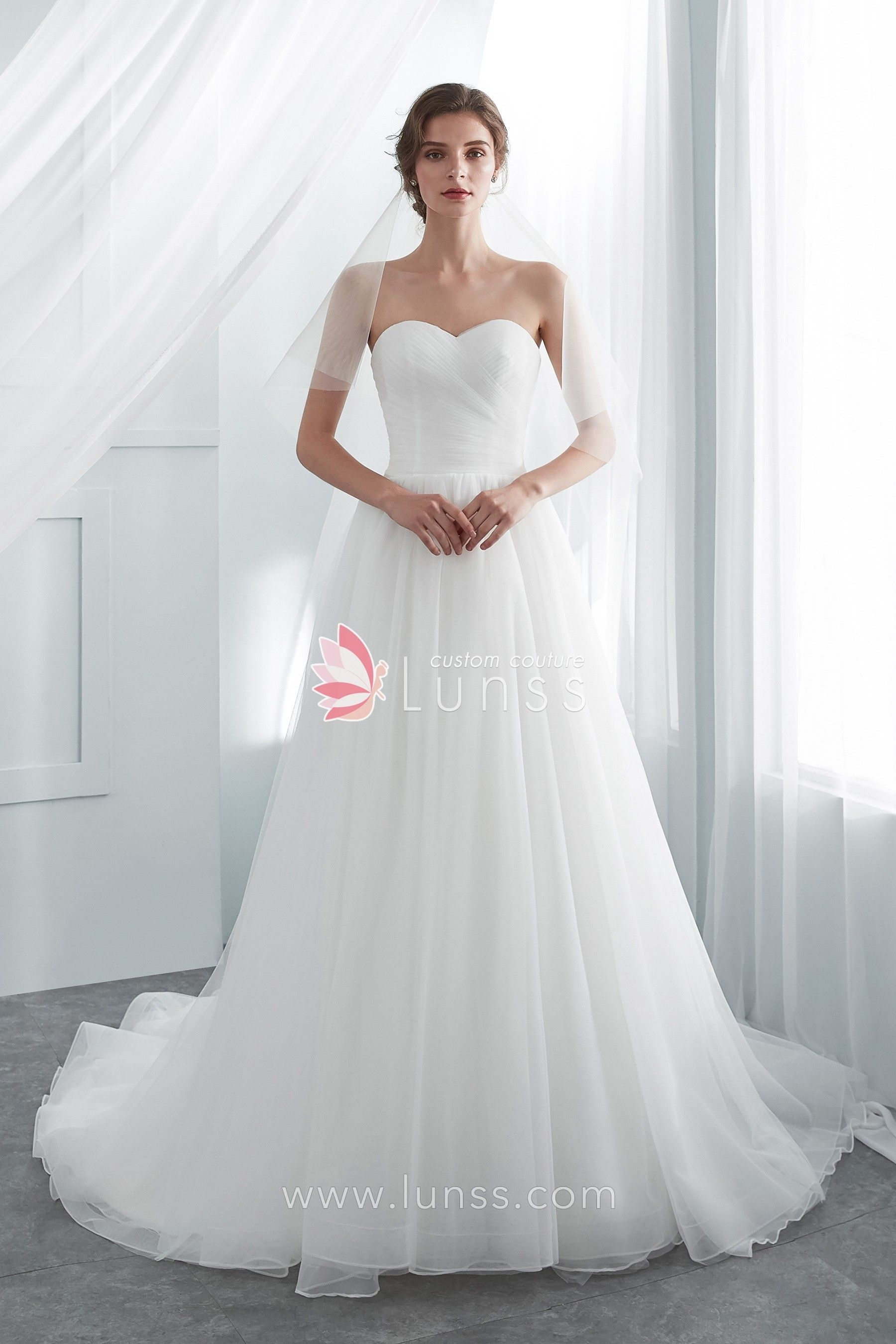 2c6145e6c28fa Sleek and chic, this soft tulle wedding gown is simple lovely with a  strapless sweetheart