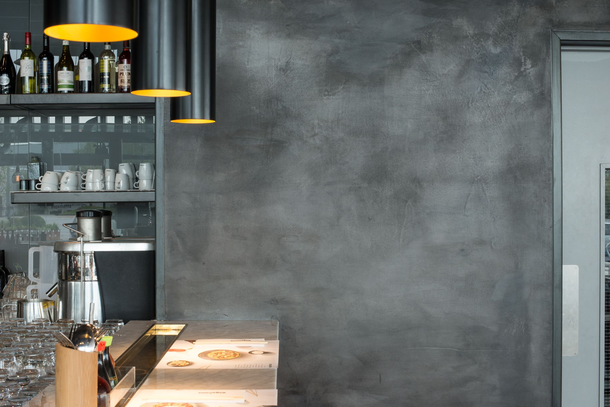 Naturally pigmented clay plasters create stunning black walls that