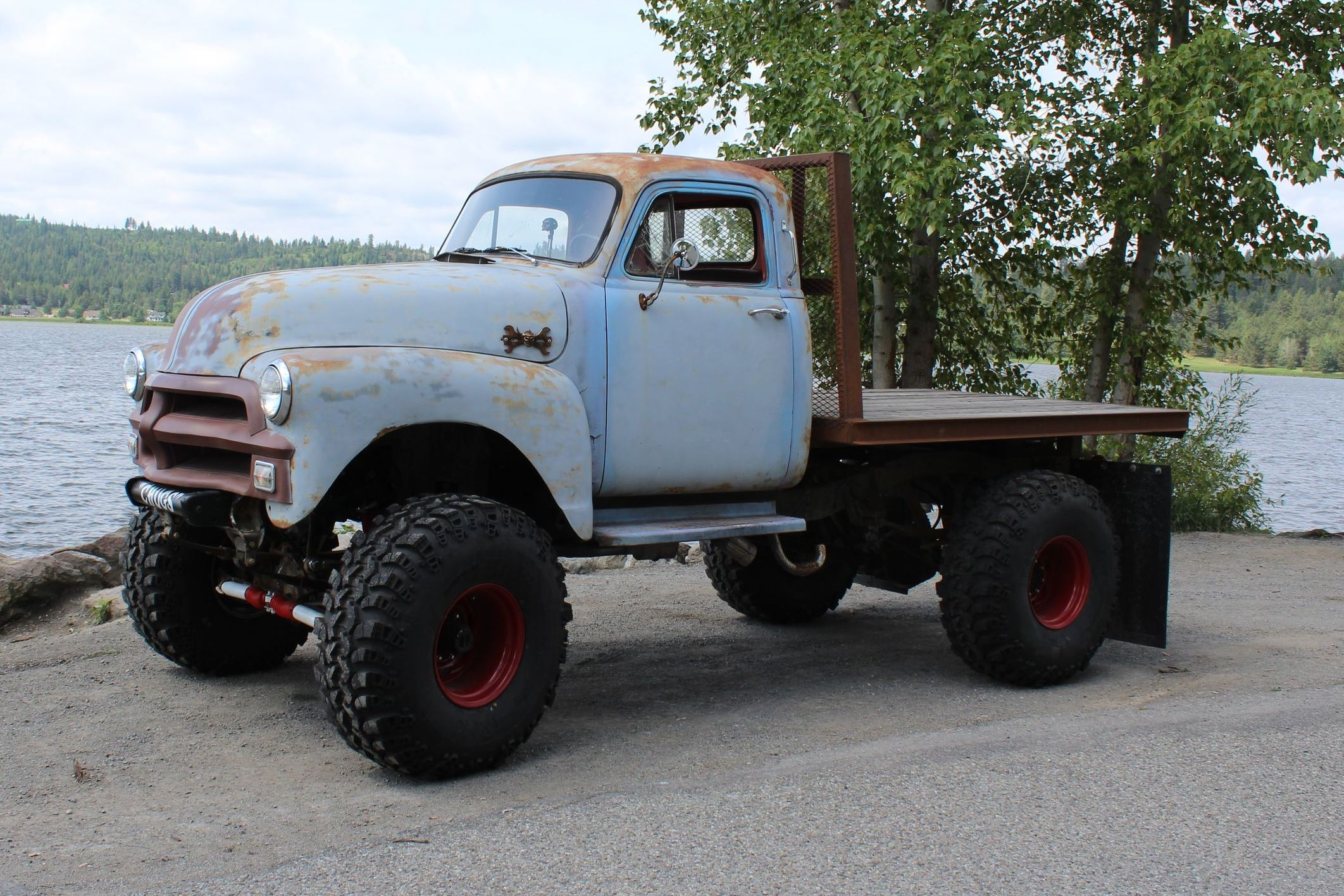 My 1954 chevy 1 ton 4x4 flatbed vintage truck i built 42 super swampers