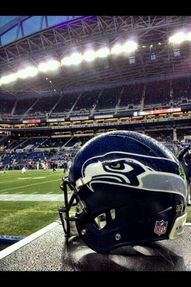 6b2d980a83 Seahawks helmet with the 12 s in the background at Century Link Field.   Gohawks
