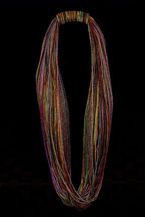 Peggy  Fontenot. Necklace made from 11/0 glass seed beads.  One hundred strands.