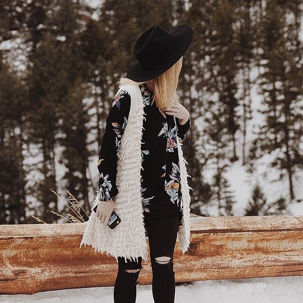 Black and white details // white fuzzy vest with black printed top + black ripped jeans is our go to winter look