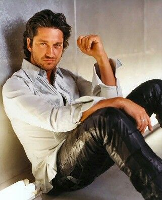 Gerard Butler in black leather pants (One of his earlier pictures.)