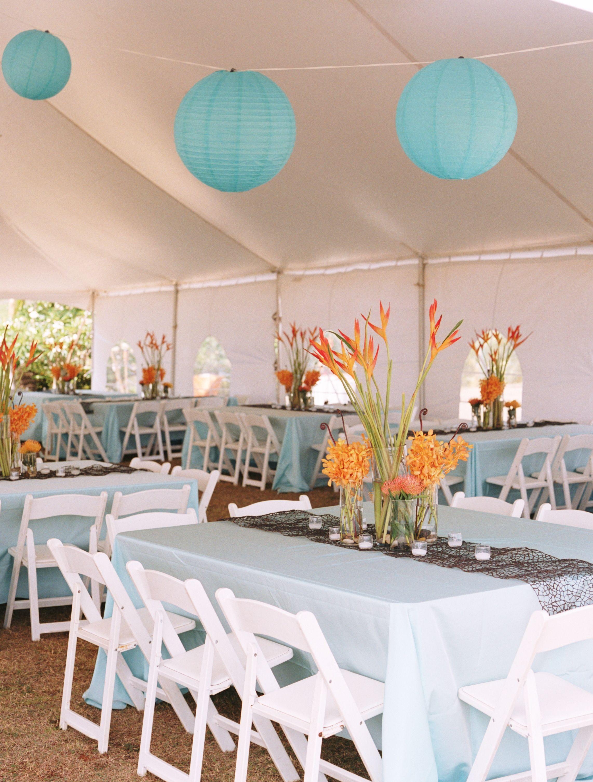 Blue wedding decor ideas  The tented receptionus palette of crisp white turquoise and orange