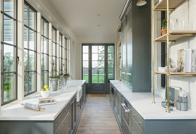 Gray butler's pantry boasts antiqued mirrored eclipse