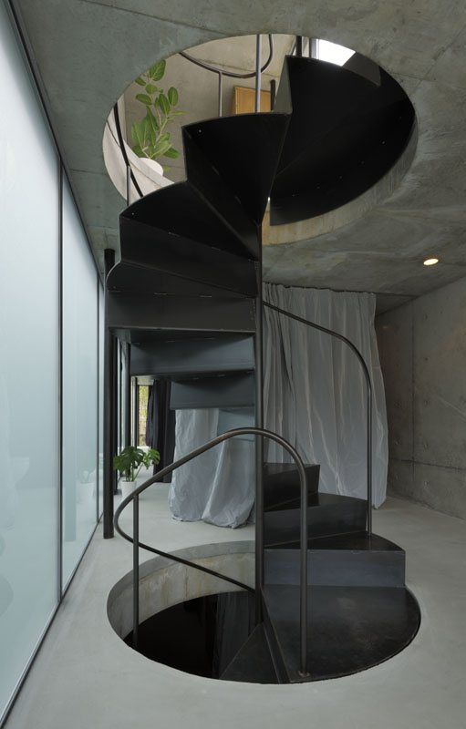 Cut out stairs that extend through the whole house... So cool!     [House in Takadanobaba, Shinjuku, 2011]