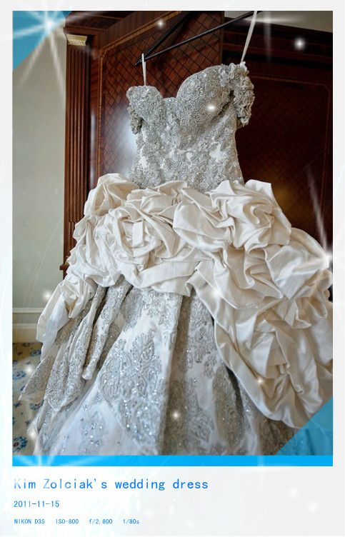 $58,000 handmade Baracci gown made of duchess satin and embellished ...