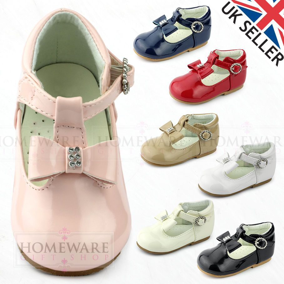 54a479524c07 Baby girls spanish style shoes t-bar bow diamante pink white camel red black