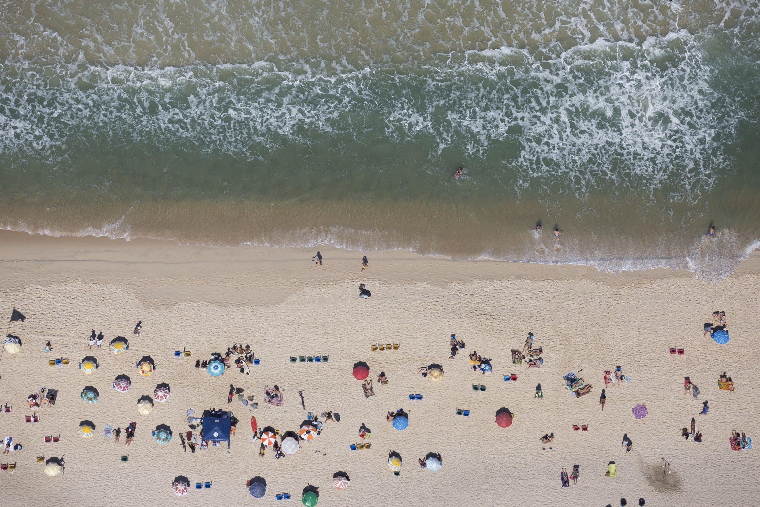 People sunbathe at Ipanema beach in Rio de Janeiro, Brazil, Monday, Aug. 1, 2016. The Summer Games start Aug. 5. (AP Photo/Felipe Dana) via…